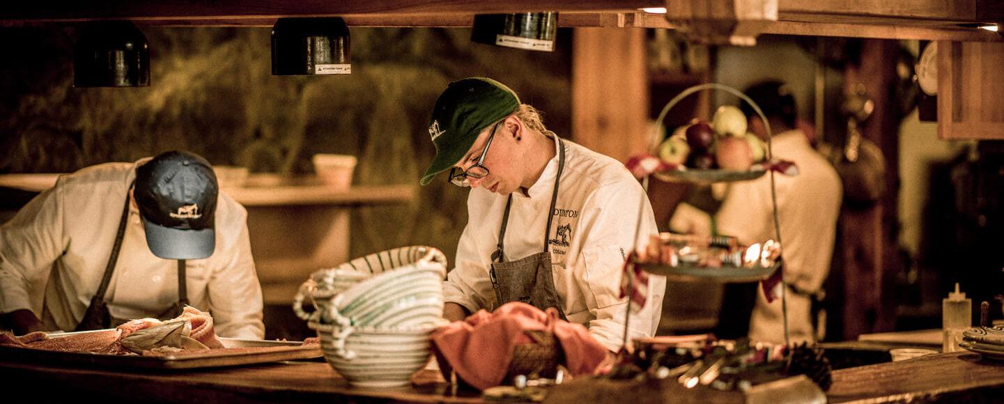 Chefs cooking in the Dunton kitchen